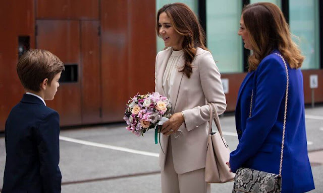 Crown Princess Mary wore a cecel SP blazer and Gytta trousers from Andiata. She carried Prada saffiano cuir double bag