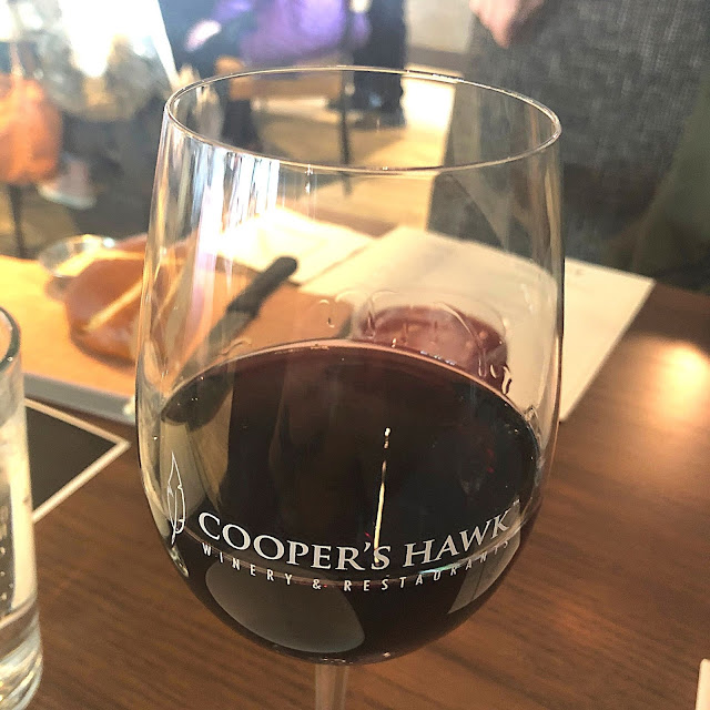 Sipping and swirling Cooper's Hawk Barbera.