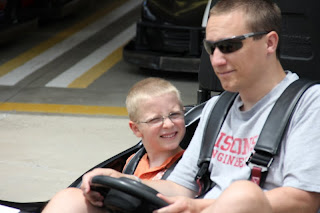 father and son driving go karts
