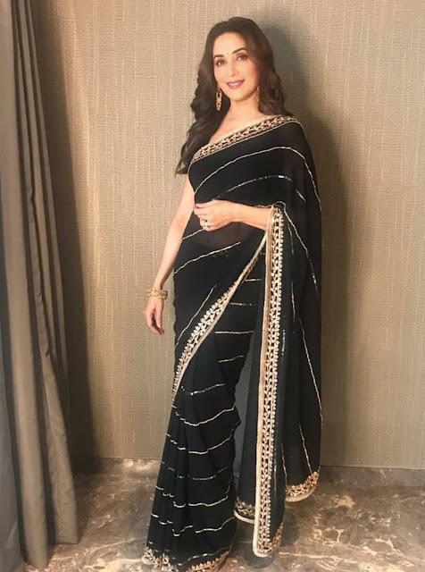 Madhuri Dixit Nene wearing a black saree -