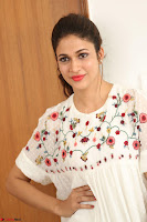 Lavanya Tripathi in Summer Style Spicy Short White Dress at her Interview  Exclusive 163.JPG