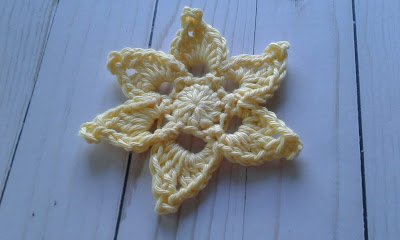 star shaped crochet flower in yellow