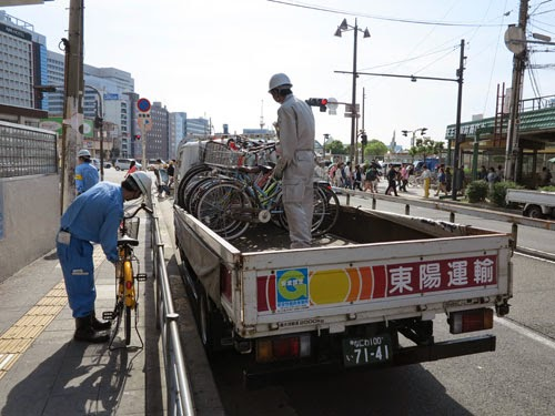 Osaka City staff collecting illegally parked bicycles, Tennoji