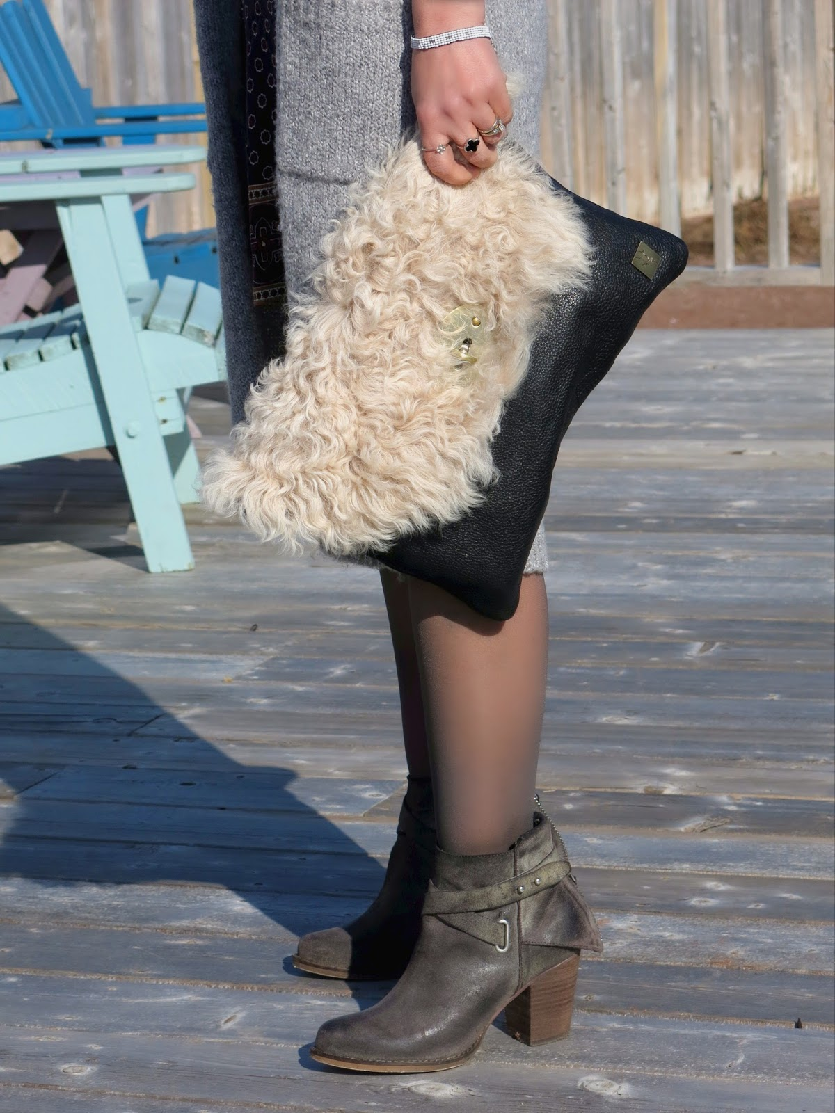 long cardigan, furry sherpa clutch, and booties
