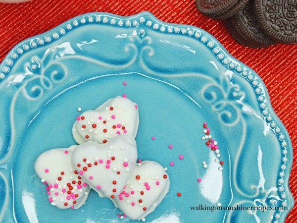 Coat the Heart Shaped Truffles with Valentines sprinkles immediately, before the coating dries and chill again in the refrigerator until the coating is set from Walking on Sunshine Recipes.