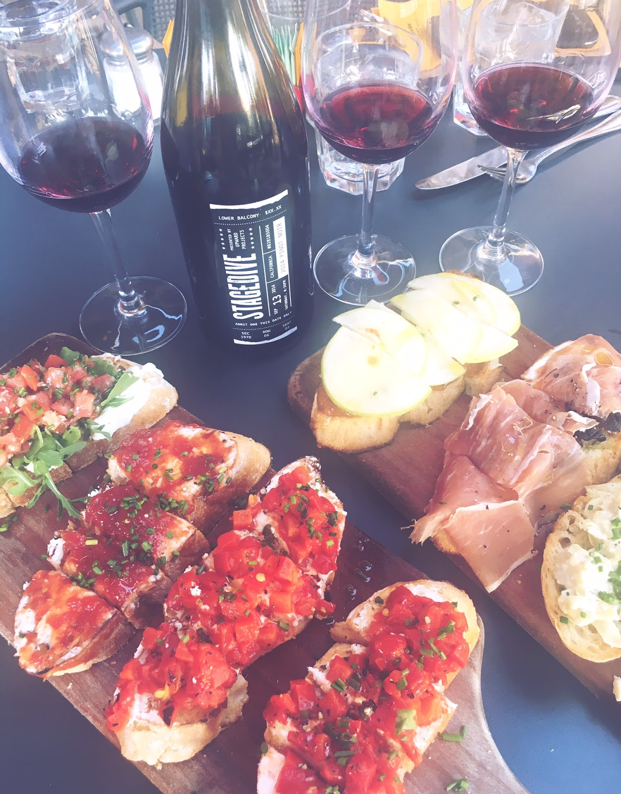Delicious bruschetta boards and a bottle of wine