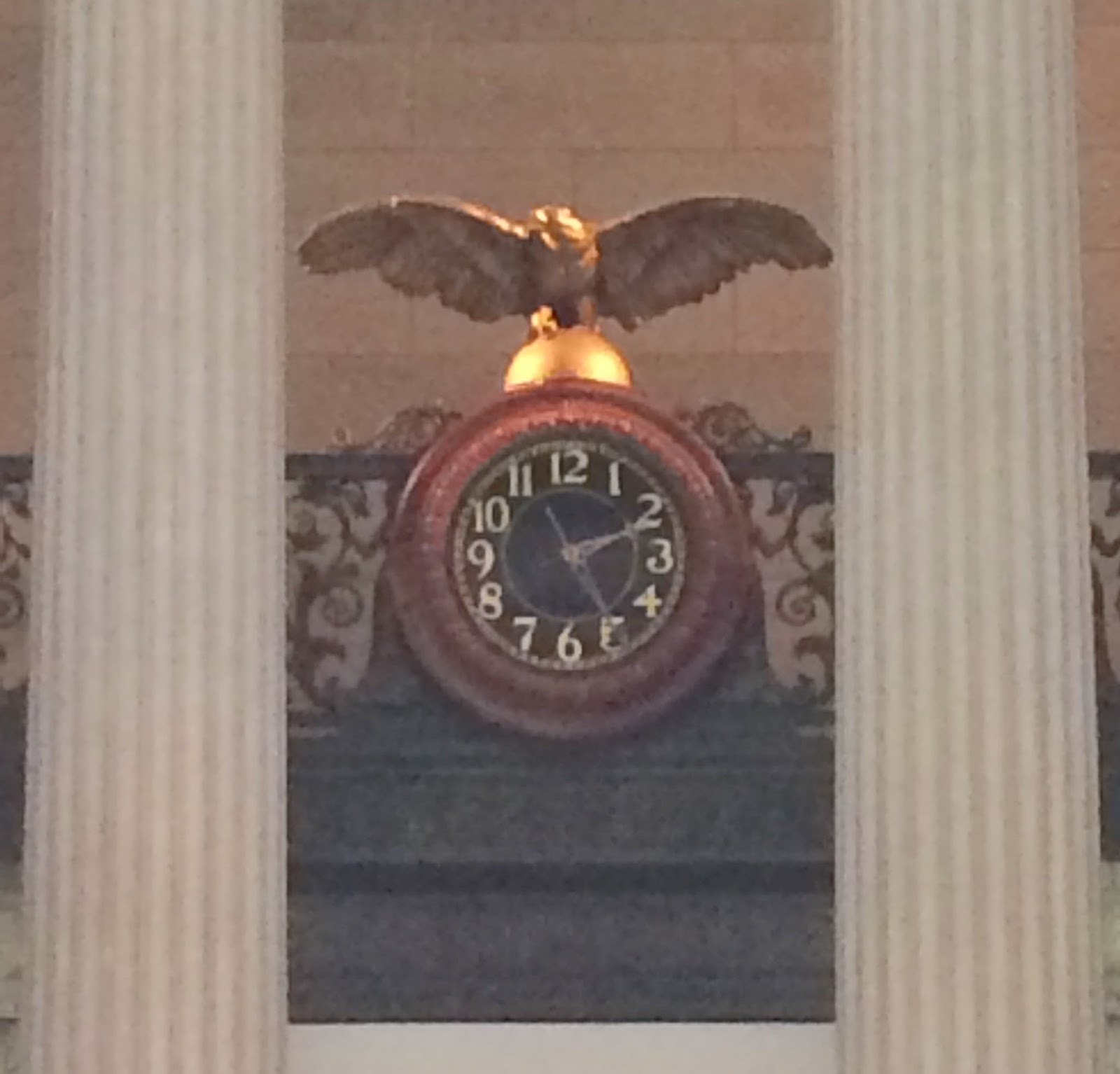 The 10 year plan july 2016 in the large rotunda of federal hall a photo of columns and the clock with a golden eagle amipublicfo Choice Image