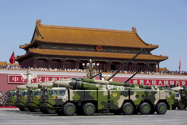 FILE PHOTO: Chinese military vehicles carrying DF-21D anti-ship ballistic missiles, potentially capable of sinking a U.S. Nimitz-class aircraft carrier in a single strike, travel past Tiananmen Gate during a military parade to commemorate the 70th anniversary of the end of World War II in Beijing Thursday, Sept. 3, 2015. REUTERS/Andy Wong/Pool/File Photo/