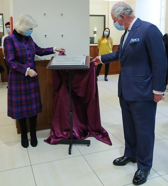 The Prince of Wales and the Duchess of Cornwall visited the Queen Elizabeth Hospital. Tartan coat dress