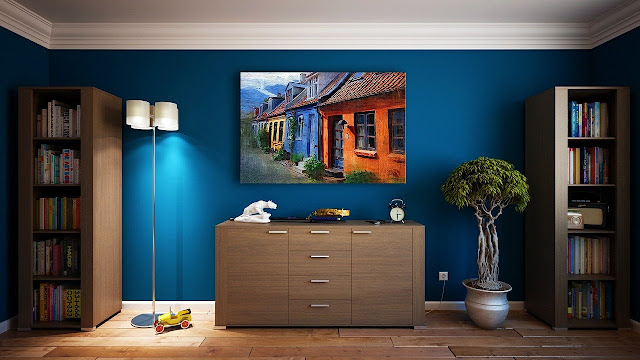 Living room furniture with a painting in the center