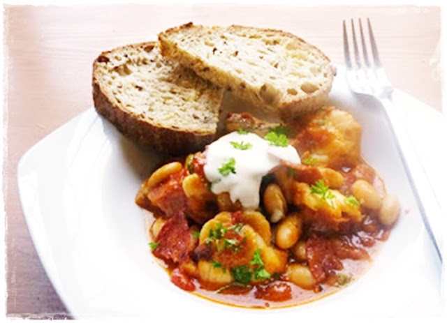 white fish with beans and chorizo in a tomato sauce