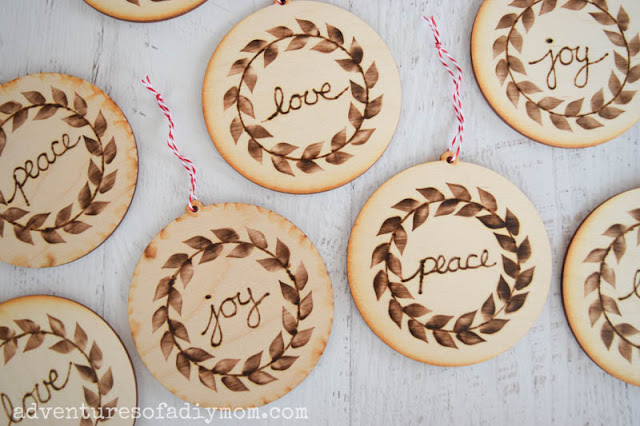 wooden ornaments decorated with wood burned details