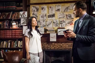 Jonny Lee Miller and Lucy Liu as Sherlock Holmes and Joan Watson in CBS Elementary Season 2 Episode 12 The Diabolical Kind