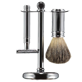 A metal stand holding a metal double edged safety razor and shaving brush for a zero waste shave