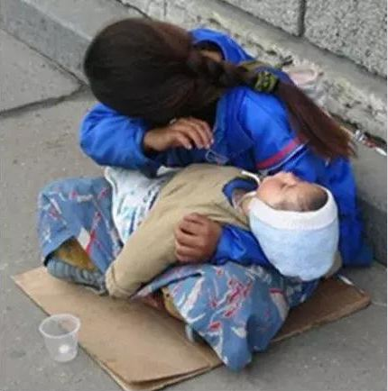 The Reason Why Babies in the Arms of a Beggar Are Always Asleep Will Shock You!