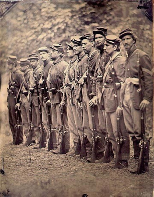 Civil War soldiers, battle weary and standing in formation. Angel's Glow. marchmatron.com