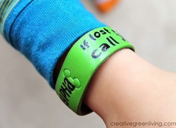 A Disneyworld magic band personalized with a phone number in case the child got lost