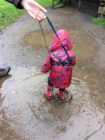 Toddler splashing in puddles