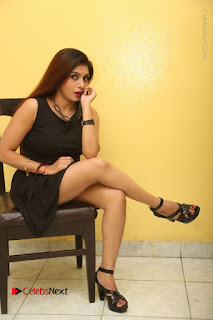 Tollywood Upcoming Actress Pooja Roshan Stills in Black Short Dress at Plus 1 Movie Trailer Launch  0323.JPG