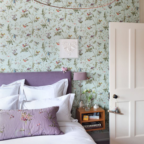 A mix of vintage and retro florals in country bedroom