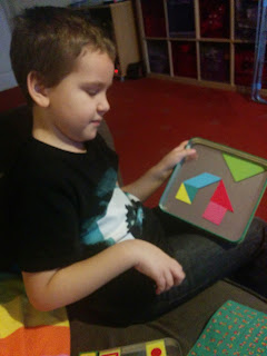 Dan Jon Jr playing tangrams