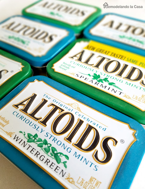 blue and green boxes of altoids metal containers
