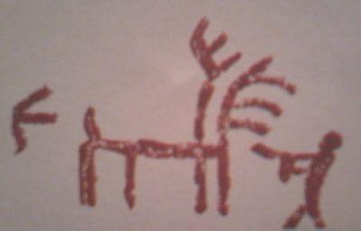 Ilustración primitiva donde aparece un ciervo y una figura humana, apuntándole con una especie de arma.