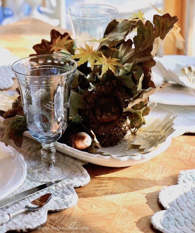 Thanksgiving Natural Centerpiece tips for using twigs, leaves, and acorns with footed blue etched glass