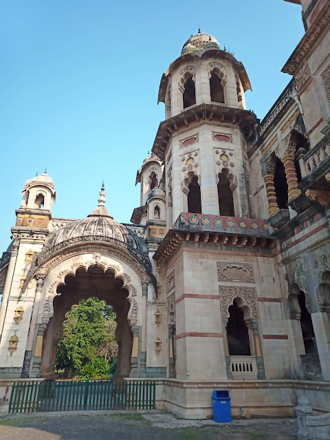 View of side of Lakshmi Vilas Palace building with turrets and domed, Indo-Gothic architecture in Vadodara