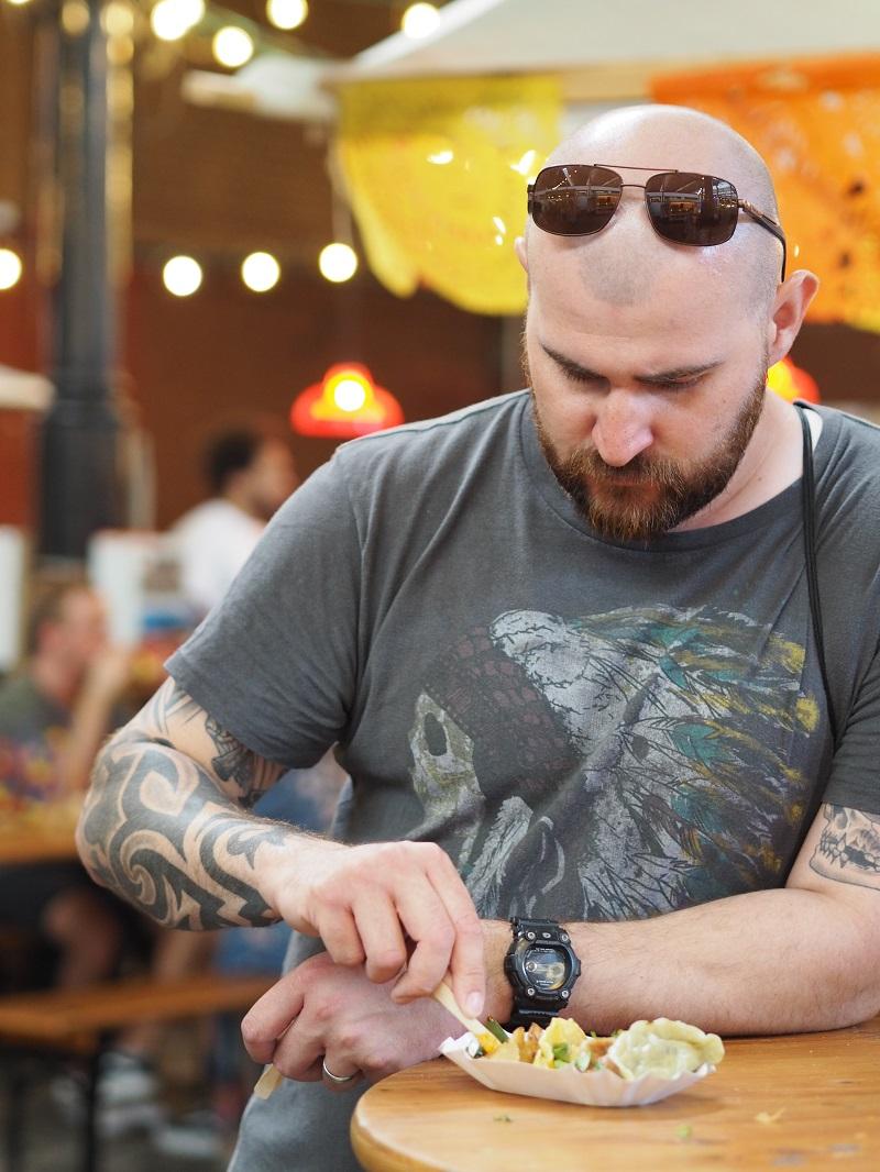 Gordon eating dumplings at Markthalle Neun