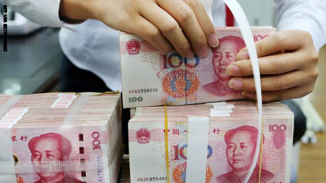 الصين تتلف وتطهر الأوراق النقدية لاحتواء فيروس كورونا