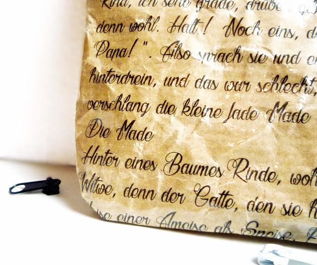 Teilansicht Mäppchen aus beschrifteten Papier, Gedicht Heinz Erhard