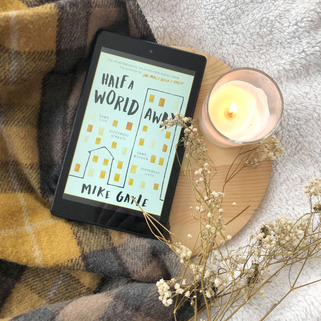 Cover of 'Half A World Away' by Mike Gayle next to a candle