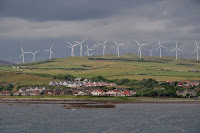 The town of Ardrossan, North Ayrshire, Scotland, surrounded by an enormous wind farm. (Credit: Vincent Van Zeijst/Wikimedia Commons) Click to Enlarge.