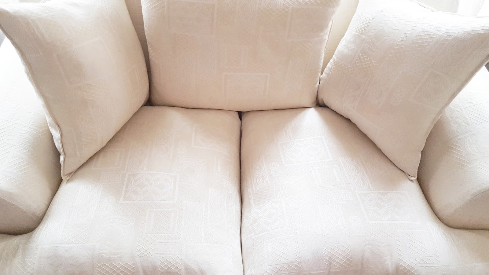 white plump sofa