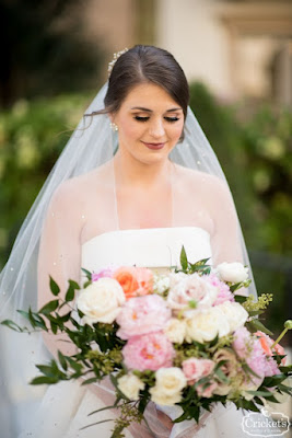 bride with ivory and pink bouquet