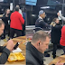 Man ignores mass brawl to calmly eating his food in a kebab shop