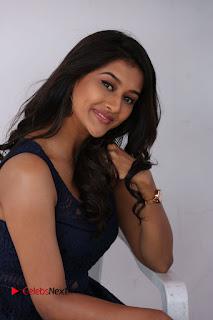 Actress Pooja Jhaveri Stills in Short Dress at Dwaraka Movie Interview .COM 0113.JPG