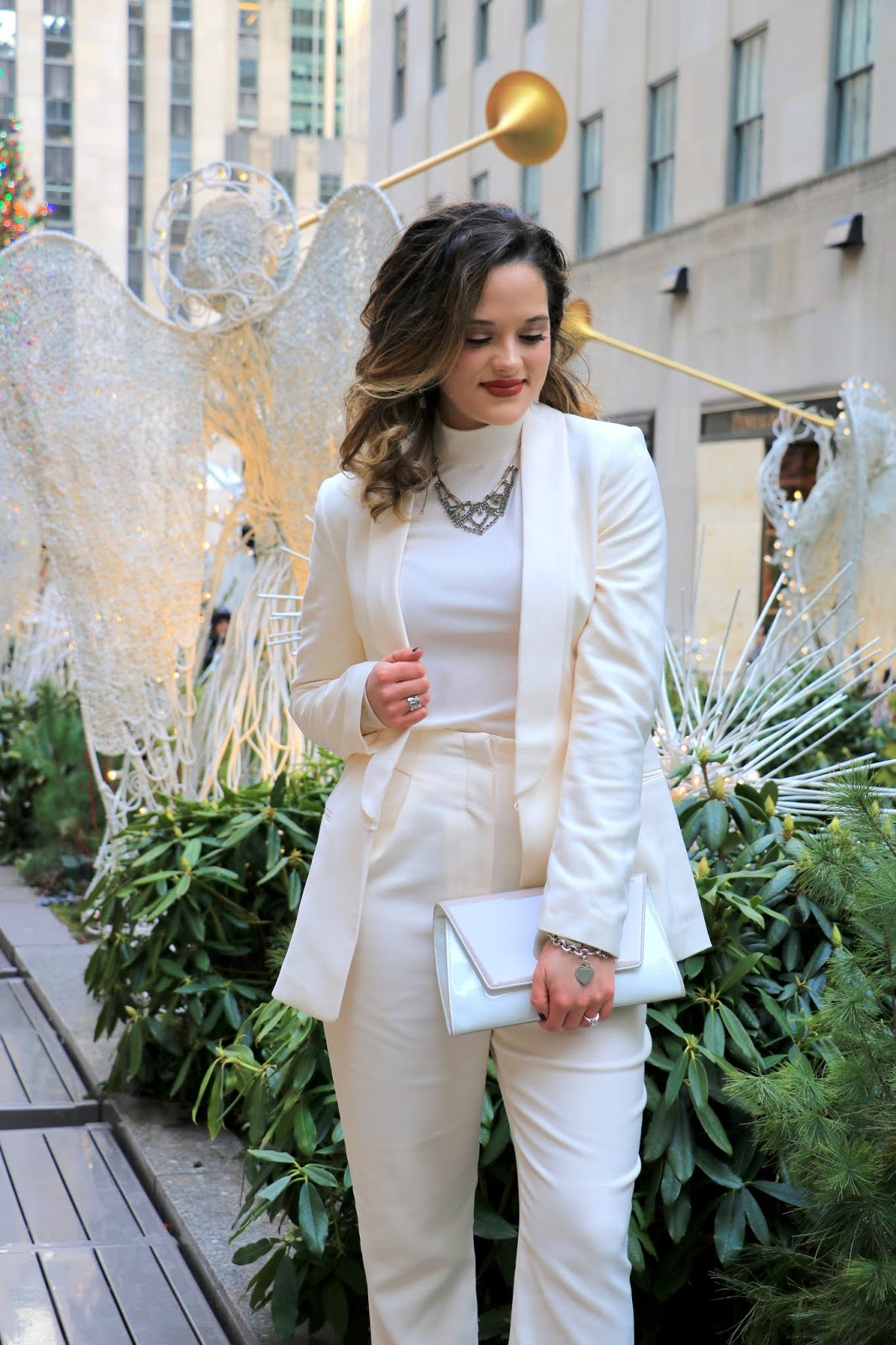 Nyc fashion blogger Kathleen Harper wearing a holiday suit.