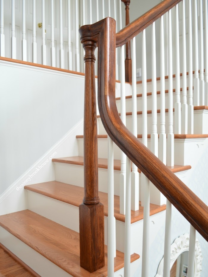 Stair post and rail stained
