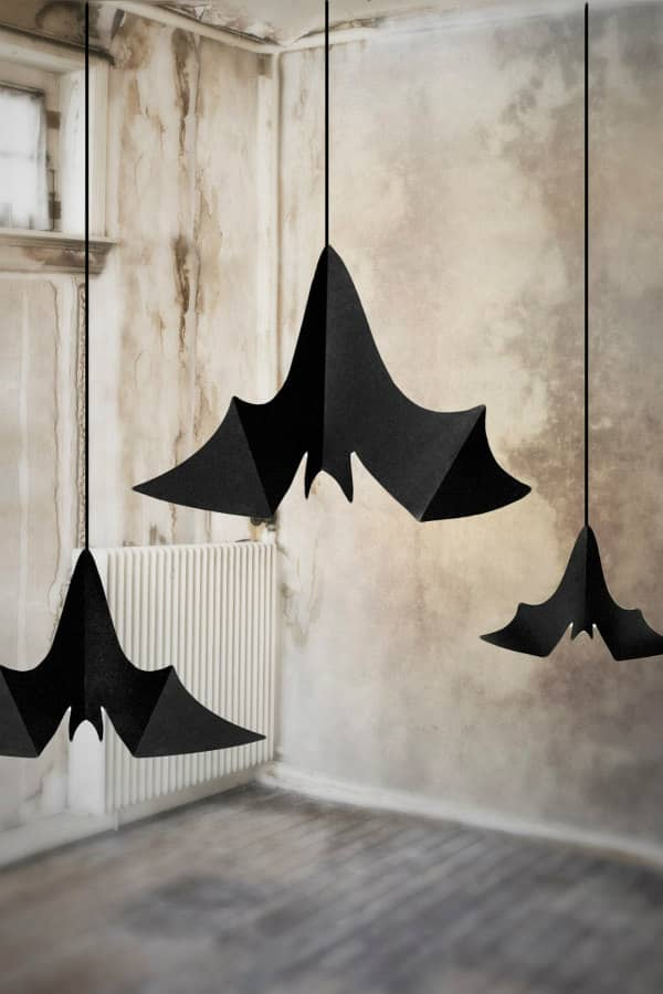 trio of paper bats suspended from ceiling