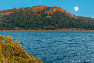 Cramer Imaging's fine art landscape photograph of the moon rising over Panguitch Lake Utah in Autumn