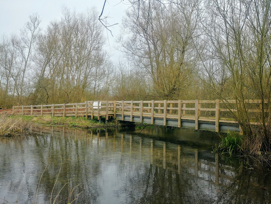 The footbridge crossing the River Ver north of the car park