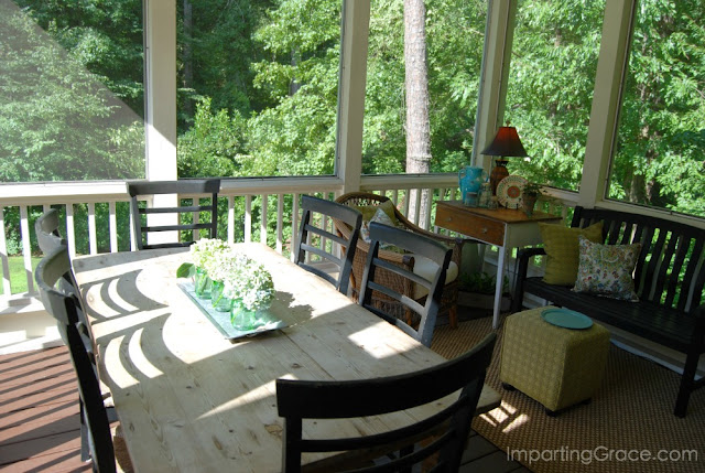 Second-story screened porch is nestled in the trees and offers a shady spot for relaxing.