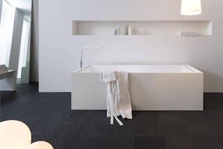 Simple modern bathroom in black floor tile with elegant white bathtub ideas