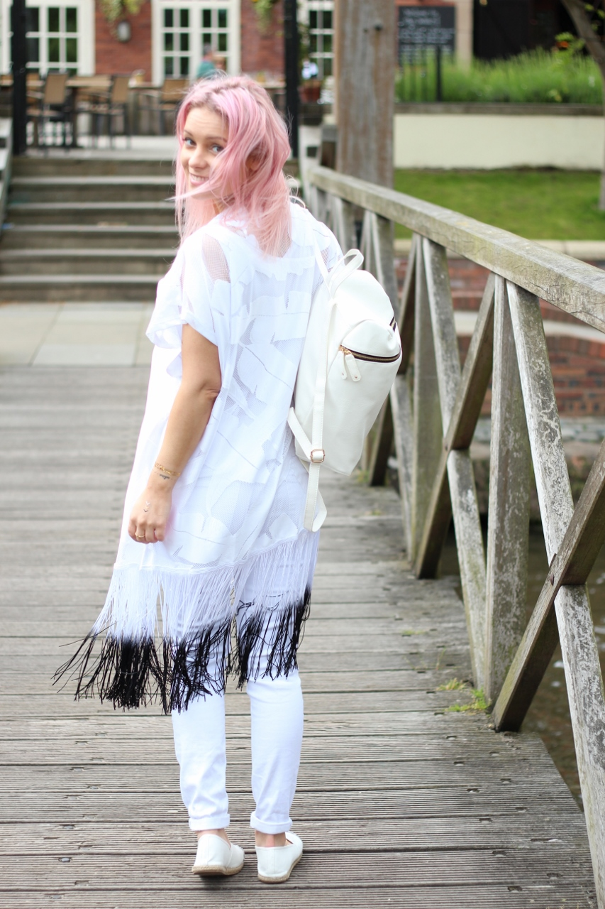 pastel pink hair girl with white backpack