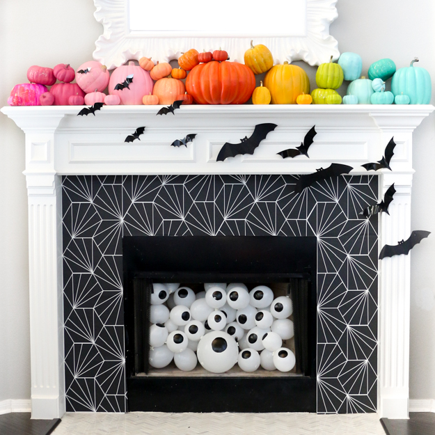 always use battery operated candles as you see above or fill your fireplace with balloons pumpkins or any other fun decor item to really make it pop