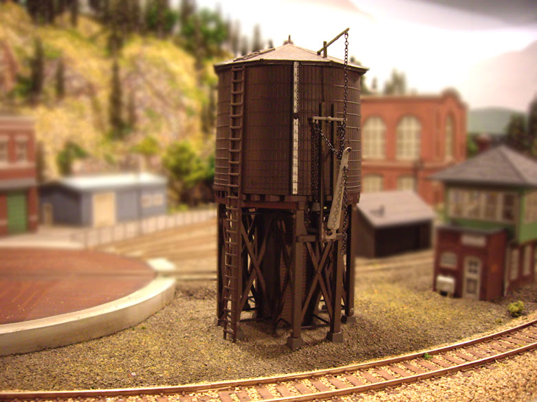 Completed Atlas Water Tower Kit installed onto a model railroad layout