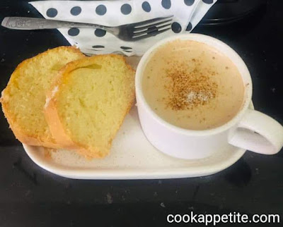 This homemade coconut cake is made from scratch with no cream cheese frosting yet it's delicious. Topped with apricot jam and sprinkled with coconut. It's a perfect dessert for a holiday or when you have guests around.