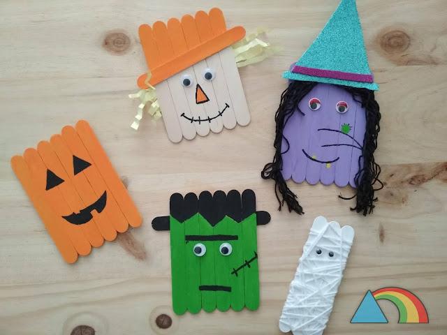 Personajes de Halloween hechos con palitos de helado: calabaza, bruza, momia, Frankenstein y espantapájaros